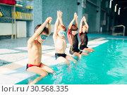Children jumping into sport swimming pool. Стоковое фото, фотограф Tryapitsyn Sergiy / Фотобанк Лори