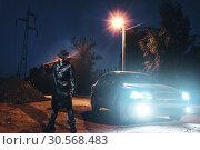 Купить «Maniac with bloody baseball bat against black car», фото № 30568483, снято 22 сентября 2017 г. (c) Tryapitsyn Sergiy / Фотобанк Лори