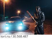 Купить «Maniac in hockey mask, baseball bat in hands», фото № 30568487, снято 22 сентября 2017 г. (c) Tryapitsyn Sergiy / Фотобанк Лори