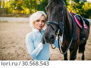 Купить «Female jockey and horse, horseback riding», фото № 30568543, снято 17 сентября 2017 г. (c) Tryapitsyn Sergiy / Фотобанк Лори