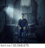 Купить «Madman, mouth sealed with plaster, psycho patient», фото № 30568675, снято 1 октября 2017 г. (c) Tryapitsyn Sergiy / Фотобанк Лори