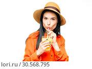 Купить «Woman drinks freshly squeezed orange juice», фото № 30568795, снято 14 октября 2017 г. (c) Tryapitsyn Sergiy / Фотобанк Лори