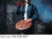 Male drummer playing on wooden drum. Стоковое фото, фотограф Tryapitsyn Sergiy / Фотобанк Лори