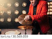 Купить «Bearded drummer in red suit on the stage», фото № 30569059, снято 10 ноября 2017 г. (c) Tryapitsyn Sergiy / Фотобанк Лори