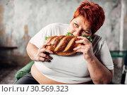 Купить «Fat woman eats sandwich, overweight and bulimic», фото № 30569323, снято 23 ноября 2017 г. (c) Tryapitsyn Sergiy / Фотобанк Лори