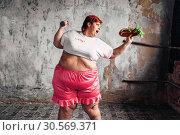 Купить «Overweight woman, fight against obesity concept», фото № 30569371, снято 23 ноября 2017 г. (c) Tryapitsyn Sergiy / Фотобанк Лори
