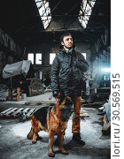 Stalker in gas mask and dog in radioactive zone. Стоковое фото, фотограф Tryapitsyn Sergiy / Фотобанк Лори