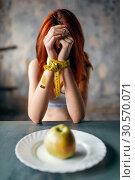 Купить «Womans hands are tied with measuring tape», фото № 30570071, снято 10 января 2018 г. (c) Tryapitsyn Sergiy / Фотобанк Лори