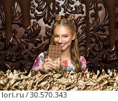 Woman with chocolate, brown sweet background. Стоковое фото, фотограф Tryapitsyn Sergiy / Фотобанк Лори