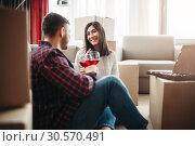 Купить «Happy couple celebrate moving to new house», фото № 30570491, снято 11 февраля 2018 г. (c) Tryapitsyn Sergiy / Фотобанк Лори