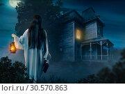Купить «Female against abondoned house, moonlit night», фото № 30570863, снято 27 февраля 2018 г. (c) Tryapitsyn Sergiy / Фотобанк Лори