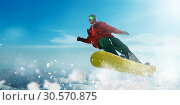 Купить «Snowboarder in glasses makes a jump, winter sport», фото № 30570875, снято 27 мая 2020 г. (c) Tryapitsyn Sergiy / Фотобанк Лори