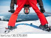 Купить «Skier in helmet and glasses, bottom view», фото № 30570891, снято 6 марта 2018 г. (c) Tryapitsyn Sergiy / Фотобанк Лори