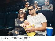 Купить «Smiling couple watching comedy movie in cinema», фото № 30570987, снято 21 марта 2018 г. (c) Tryapitsyn Sergiy / Фотобанк Лори