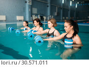 Купить «Group doing exercise with dumbbells, aqua aerobics», фото № 30571011, снято 28 марта 2018 г. (c) Tryapitsyn Sergiy / Фотобанк Лори