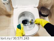 Купить «Housemaid in gloves cleans the toilet with brush», фото № 30571243, снято 14 апреля 2018 г. (c) Tryapitsyn Sergiy / Фотобанк Лори