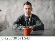 Купить «Alone autistic man, autism syndrome», фото № 30571543, снято 22 апреля 2018 г. (c) Tryapitsyn Sergiy / Фотобанк Лори