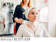 Купить «Hairdresser and female client, hair coloring process», фото № 30571639, снято 29 апреля 2018 г. (c) Tryapitsyn Sergiy / Фотобанк Лори