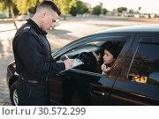 Купить «Male police officers check vehicle on the road», фото № 30572299, снято 6 июня 2018 г. (c) Tryapitsyn Sergiy / Фотобанк Лори
