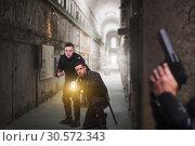 Купить «Cops with guns and lantern, front view», фото № 30572343, снято 6 июня 2018 г. (c) Tryapitsyn Sergiy / Фотобанк Лори