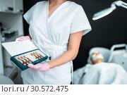Beautician shows ampoules, drug for rejuvenation. Стоковое фото, фотограф Tryapitsyn Sergiy / Фотобанк Лори