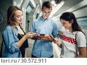 Купить «Phone addict youth using gadgets in subway», фото № 30572911, снято 3 июля 2018 г. (c) Tryapitsyn Sergiy / Фотобанк Лори