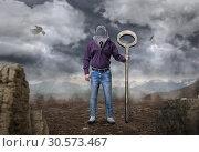 Man with keyhole instead of a head holds large key. Стоковое фото, фотограф Tryapitsyn Sergiy / Фотобанк Лори