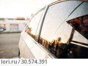 Купить «Car glass with drops of wax closeup, side view», фото № 30574391, снято 21 сентября 2018 г. (c) Tryapitsyn Sergiy / Фотобанк Лори