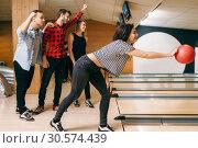 Female bowler on lane, ball throwing in action. Стоковое фото, фотограф Tryapitsyn Sergiy / Фотобанк Лори