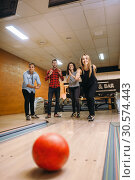 Female bowler throwing, view on rolling ball. Стоковое фото, фотограф Tryapitsyn Sergiy / Фотобанк Лори