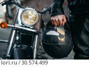Купить «Biker in leather jacket with helmet in hand», фото № 30574499, снято 7 октября 2018 г. (c) Tryapitsyn Sergiy / Фотобанк Лори