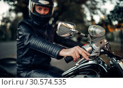 Biker in helmet poses on classical chopper. Стоковое фото, фотограф Tryapitsyn Sergiy / Фотобанк Лори