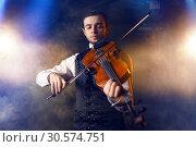 Купить «Male violinist playing classical music on violin», фото № 30574751, снято 4 марта 2017 г. (c) Tryapitsyn Sergiy / Фотобанк Лори