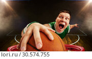 Купить «Bizarre basketball player shooting ball to basket», фото № 30574755, снято 9 апреля 2011 г. (c) Tryapitsyn Sergiy / Фотобанк Лори