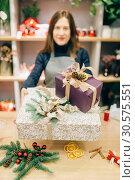 Купить «Wrapping service seller with festive gift boxes», фото № 30575551, снято 23 ноября 2018 г. (c) Tryapitsyn Sergiy / Фотобанк Лори