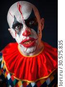 Купить «Portrait of mad bloody clown, face in blood», фото № 30575835, снято 7 декабря 2018 г. (c) Tryapitsyn Sergiy / Фотобанк Лори