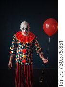 Купить «Ugly bloody clown with human finger in his teeth», фото № 30575851, снято 7 декабря 2018 г. (c) Tryapitsyn Sergiy / Фотобанк Лори