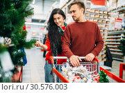Купить «Couple buying christmas tree in supermarket», фото № 30576003, снято 13 декабря 2018 г. (c) Tryapitsyn Sergiy / Фотобанк Лори