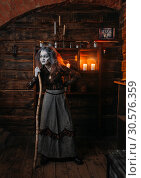 Scary witch stands leaning on a cane, seance. Стоковое фото, фотограф Tryapitsyn Sergiy / Фотобанк Лори