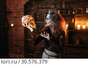 Купить «Witch reads the spell, ritual with human skull», фото № 30576379, снято 29 января 2019 г. (c) Tryapitsyn Sergiy / Фотобанк Лори