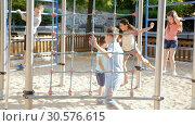 Купить «Glad children playing at the playground», видеоролик № 30576615, снято 23 июля 2018 г. (c) Яков Филимонов / Фотобанк Лори