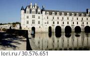 Купить «View of famous castle of Loire valley - Chateau de Chenonceau spanning Cher river, France», видеоролик № 30576651, снято 27 октября 2018 г. (c) Яков Филимонов / Фотобанк Лори