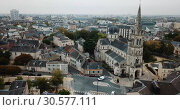 Купить «Aerial view of picturesque Chateauroux cityscape with Catholic Church of Our Lady, central France», видеоролик № 30577111, снято 7 октября 2018 г. (c) Яков Филимонов / Фотобанк Лори