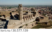 Купить «View from drone of Catalan city of Lleida with medieval Cathedral of St. Mary of La Seu Vella», видеоролик № 30577139, снято 20 июня 2018 г. (c) Яков Филимонов / Фотобанк Лори