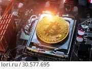 Купить «Golden bitcoin among the electronic computer details. Business concept of digital cryptocurrency», фото № 30577695, снято 4 апреля 2019 г. (c) Зезелина Марина / Фотобанк Лори