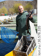 Купить «Portrait of man fish farm worker», фото № 30578335, снято 16 февраля 2020 г. (c) Яков Филимонов / Фотобанк Лори