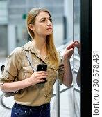 Купить «Attractive girl looking for convenient route on the subway map», фото № 30578431, снято 31 марта 2019 г. (c) Яков Филимонов / Фотобанк Лори