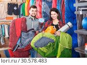 Young couple demonstrating tourist equipment. Стоковое фото, фотограф Яков Филимонов / Фотобанк Лори