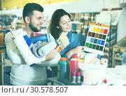 Купить «Couple examining color scheme variants», фото № 30578507, снято 9 марта 2017 г. (c) Яков Филимонов / Фотобанк Лори