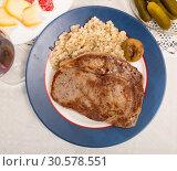 Купить «Barley porridge with frying beef at plate on table», фото № 30578551, снято 27 июня 2019 г. (c) Яков Филимонов / Фотобанк Лори